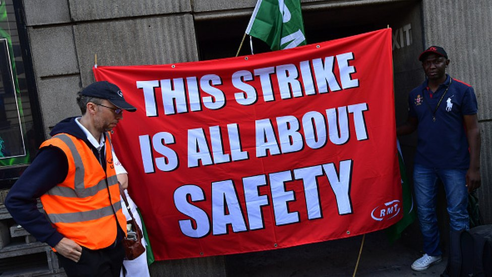 Union members man a picket line at Victoria station