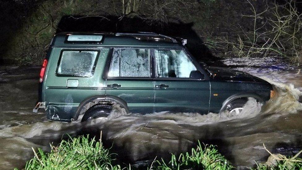 Land Rover stuck in Clough Brook