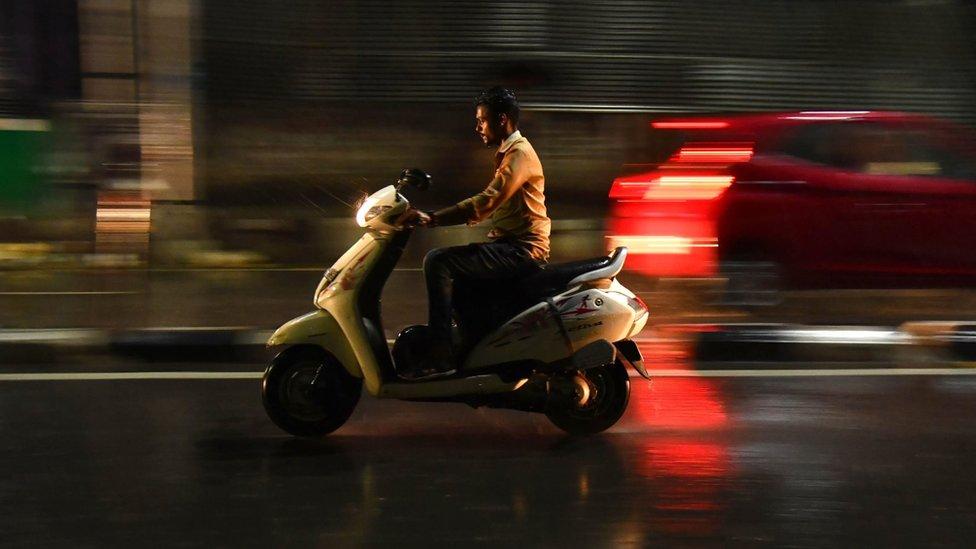 A man riding a bike without helmet