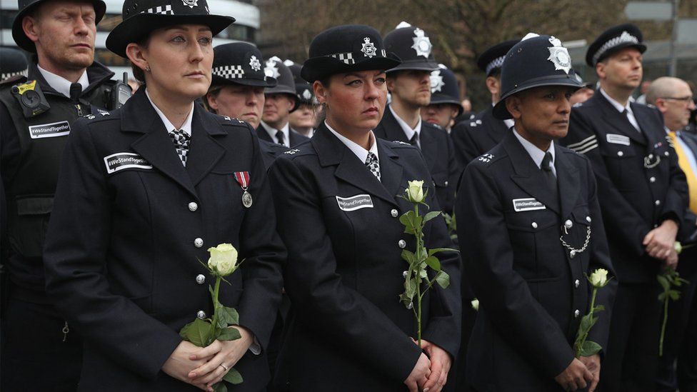 Police officers joined the crowds in remembering the victims of last Wednesday's attack