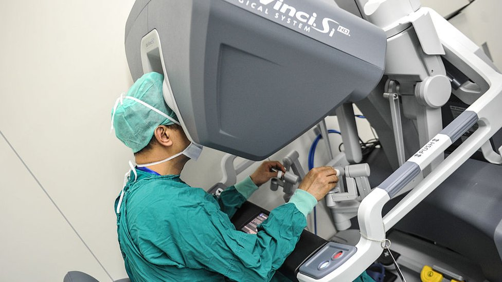 A surgeon operates a surgical robot at the First Affiliated Hospital of Sun Yat-sen University; 15 April 2015, in Guangzhou