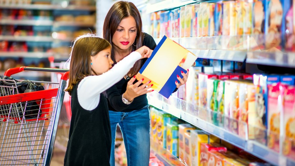 Mum and daughter shopping for cereals
