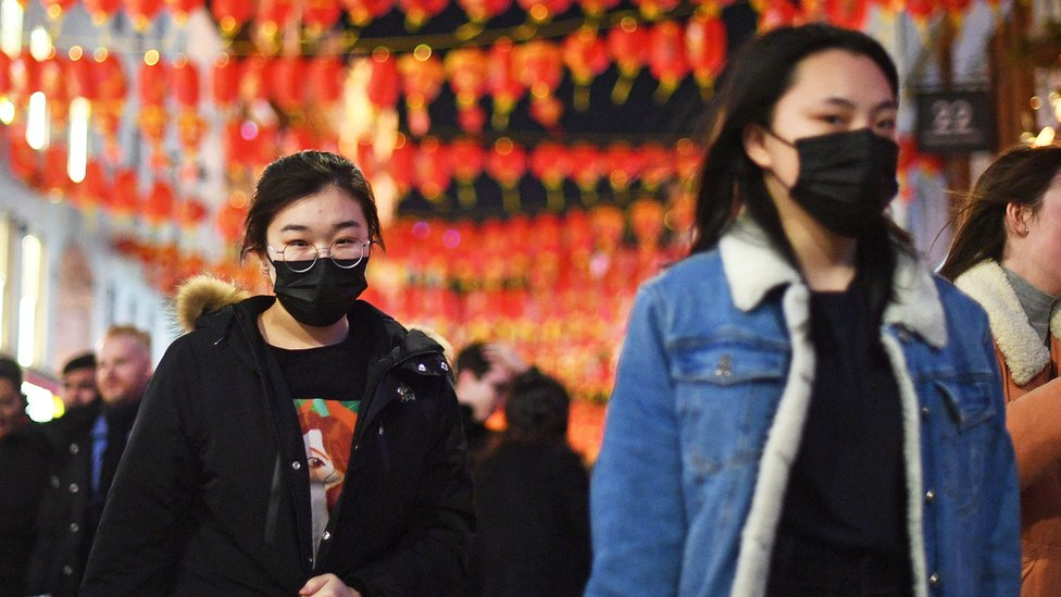 People wearing masks in Chinatown