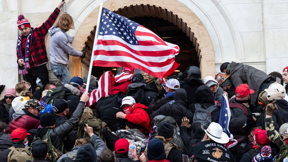 Rioters clash with police trying to enter Capitol building through the front doors - 6 January 2021