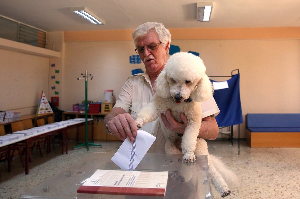 A man casts his vote during the general election at a polling station in Athens, Greece
