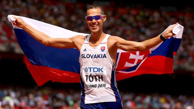 Matej Toth celebrates winning the 50km walk