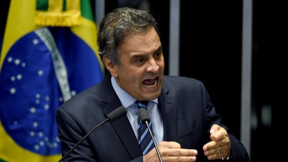 Brazilian senator Aecio Neves, from PSDB, delivers a speech during the debate in the Senate of a vote on suspending President Dilma Rousseff and launching an impeachment trial, in Brasilia on May 11, 2016