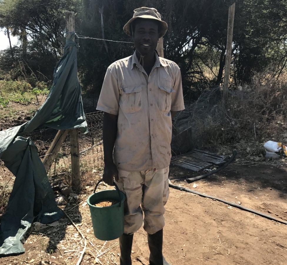 Farmer Chibeya Longwani shows me his bucket of tabasco chillies
