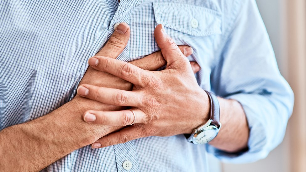 Man with hands over heart