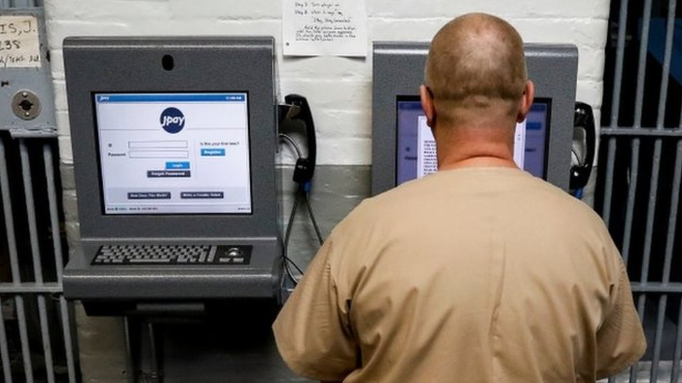 An inmate in New Jersey demonstrates JPay, an online network used by prisoners