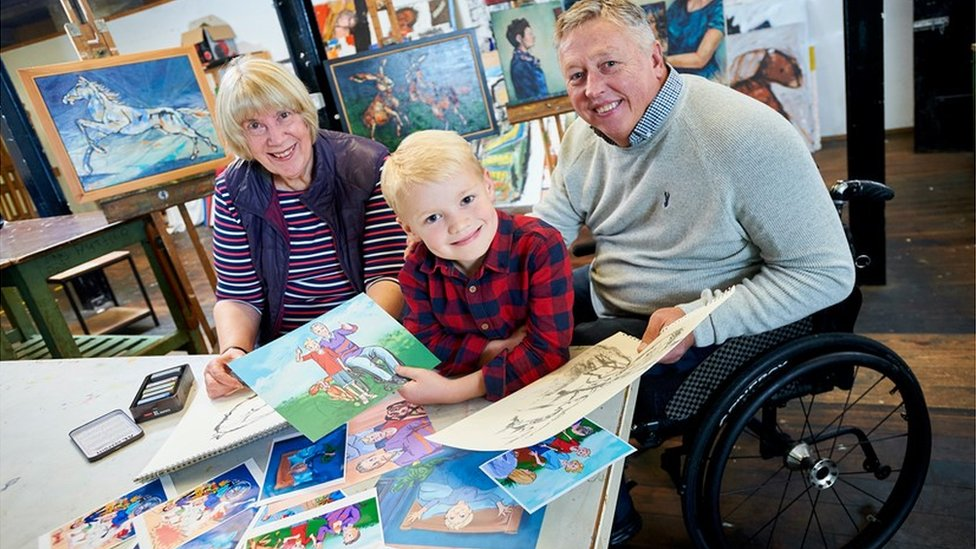 Brian Abram with grandson Charles and illustrator Lynne Hickin