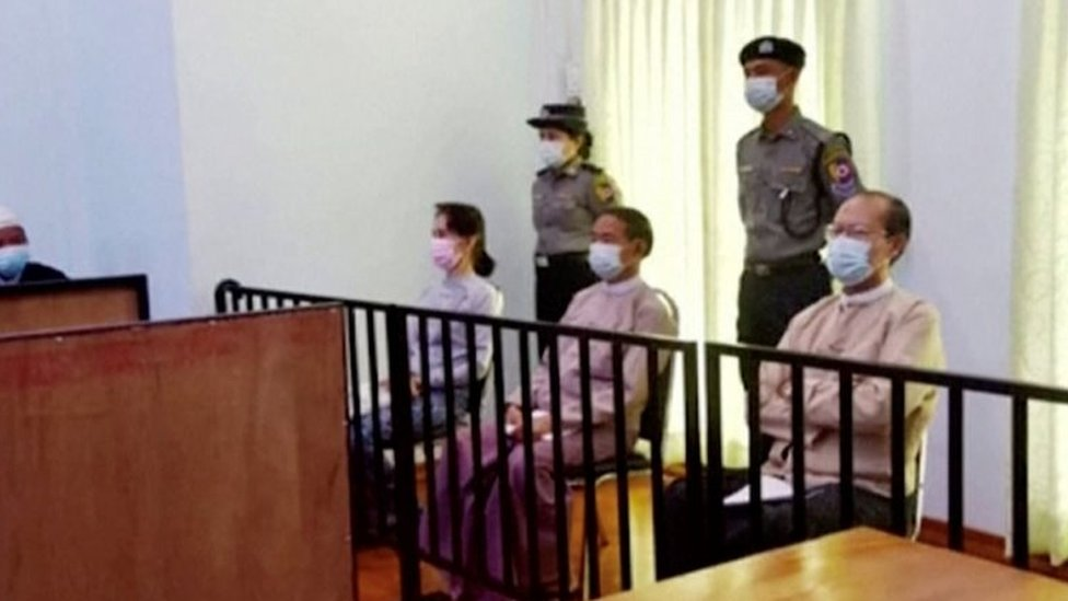 Myanmar's ousted leader Aung San Suu Kyi, former president Win Myint and doctor Myo Aung appear at a court in Naypyitaw,