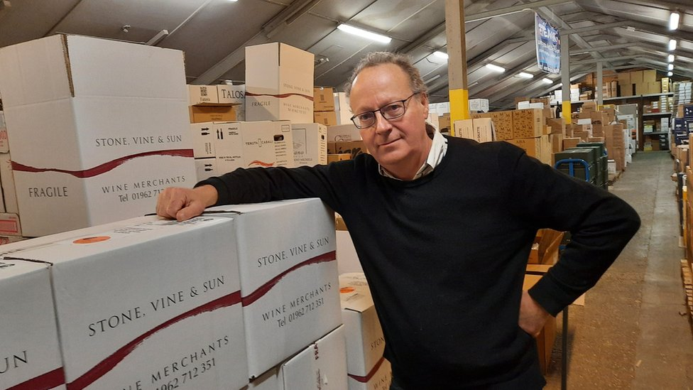 Wine merchant Simon Taylor in his warehouse