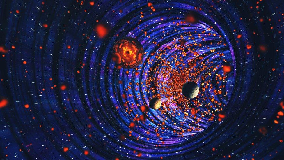 Representación gráfica de un agujero negro.