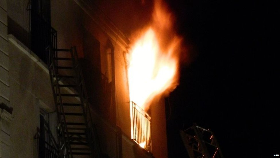 Flames billow out of a window at an apartment building in Paris. Photo: 2 September 2015