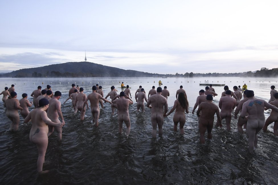 Swimmers take part in the Winter Solstice Nude Charity Swim in Canberra