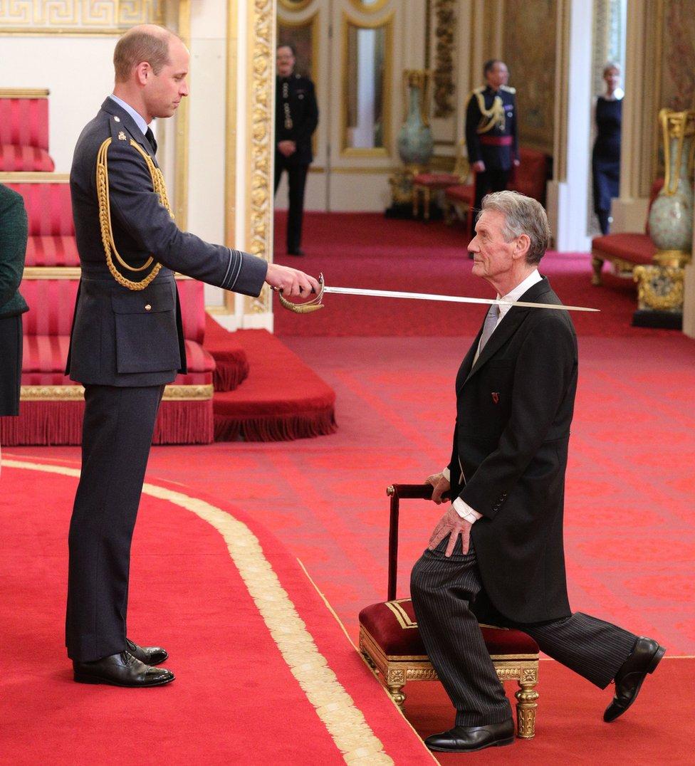 The Duke of Cambridge knighting Michael Palin