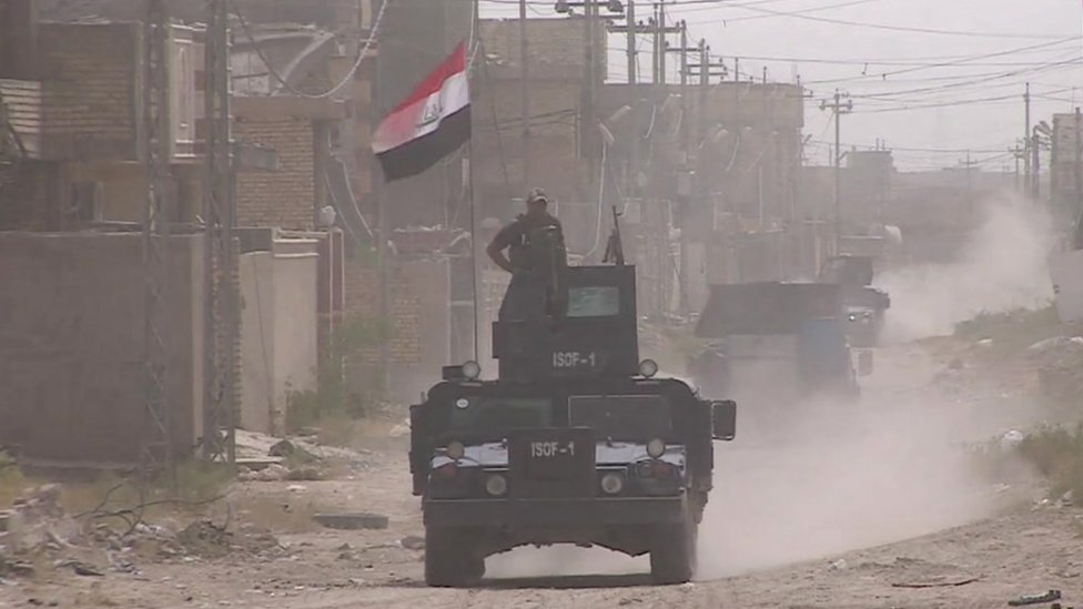 Military vehicle with Iraq flag
