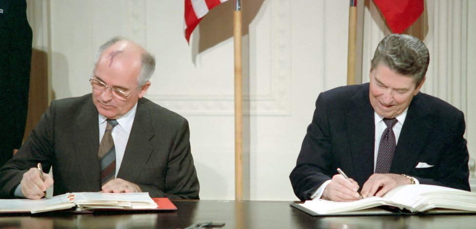General Secretary Mikhail S. Gorbachev of the Soviet Union and President Ronald Reagan sign the Intermediate-Range Nuclear Forces Treaty at the White House on December 8, 1987.