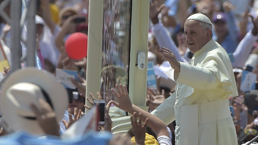 Pope Francis waves from the popemobile upon arrival for an open-air mass at Samanes Park in Guayaquil, Ecuador, on July 6, 2015.