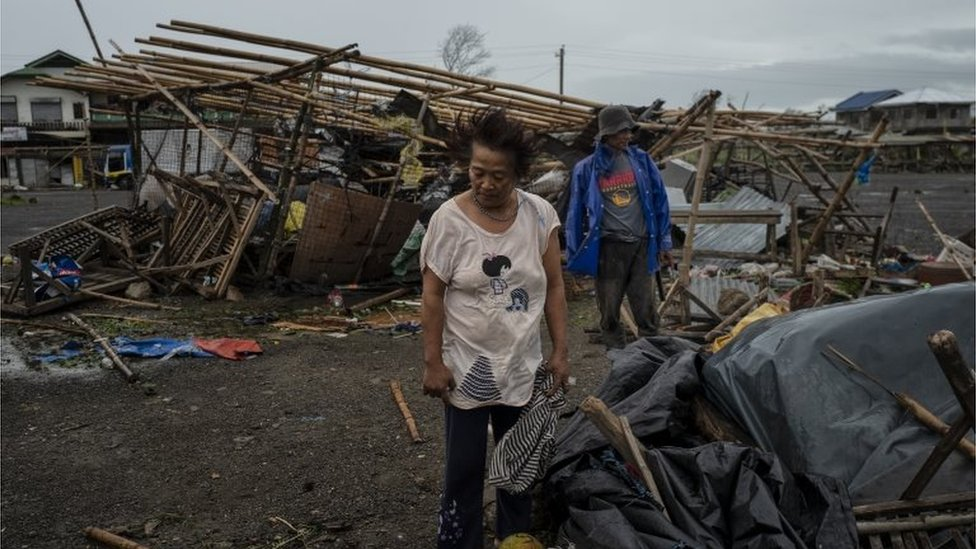 Residents inspect damage in Alcala, Philippines, after Typhoon Mangkhut battered the north, 15 September, 2018