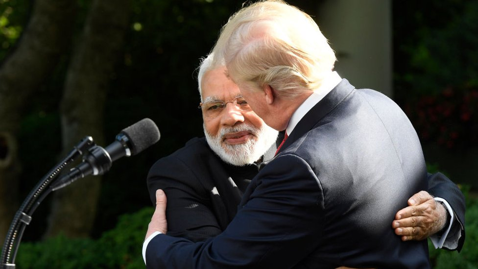 Donald Trump hugs Modi