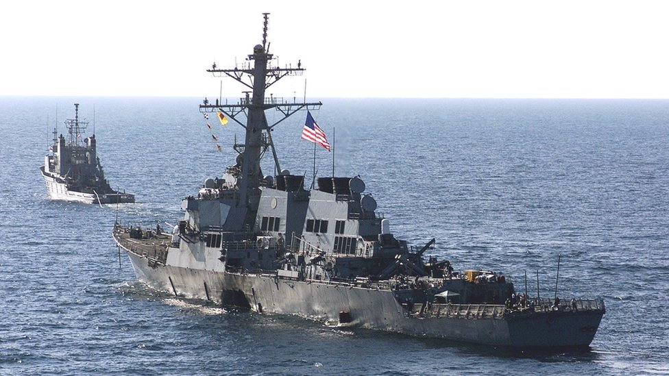 The USS Cole being towed away from Aden after the attack, 29 October 2000
