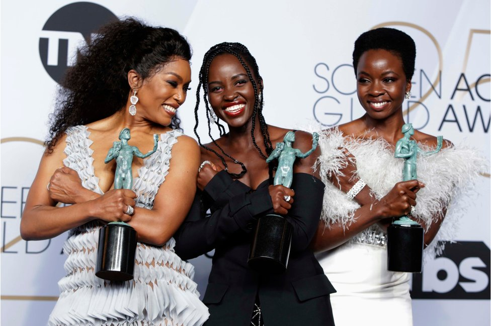 Angela Bassett, Lupita Nyong'o and Danai Gurira pose backstage