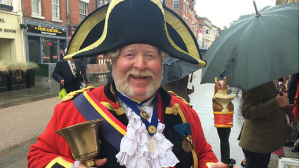Gloucester town crier 'hurled bell' at boys on bikes