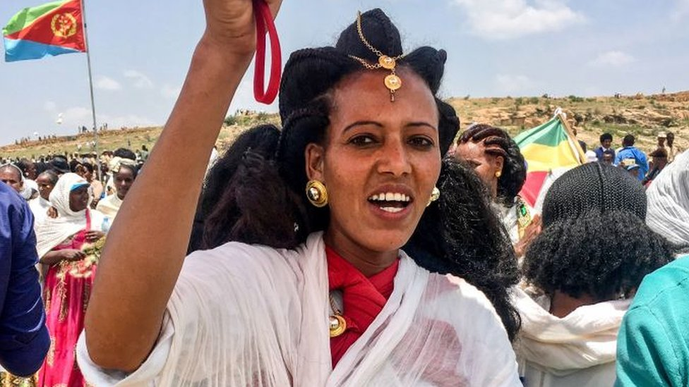 An Eritrean woman sings after crossing the border to attend the reopening border ceremony on September 11, 2018