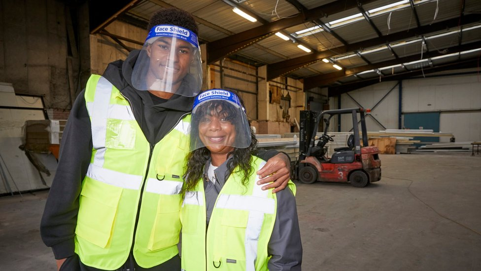 Rashford and his mum during a visit to the Greater Manchester chapter of charity FareShare, which is naming a new warehouse in honour of his mother Melanie, on 23 October