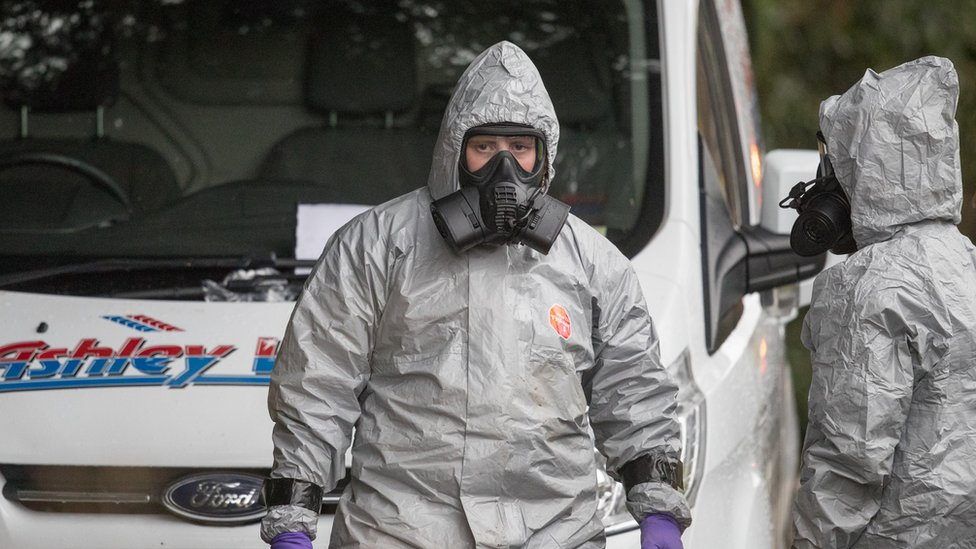 Investigators in protective clothing remove a van from an address in Winterslow near Salisbury, as police and members of the armed forces continue to investigate the suspected nerve agent attack on Russian double agent Sergei Skripal on March 12, 2018