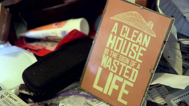 Poster reading 'A clean house is the sign of a wasted life'