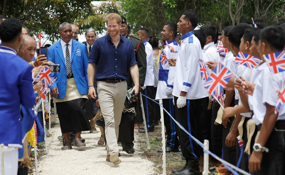Prince Harry, Duke of Sussex, is greeted by students during a visit to Tupou College in Tonga on 26 October 2018