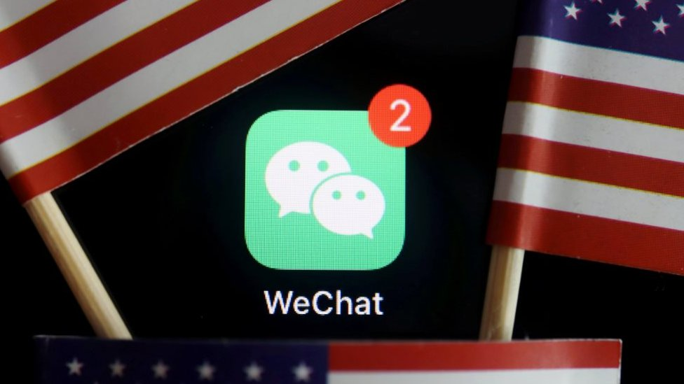 The messenger app WeChat is seen among U.S. flags in this illustration picture taken Aug. 7, 2020