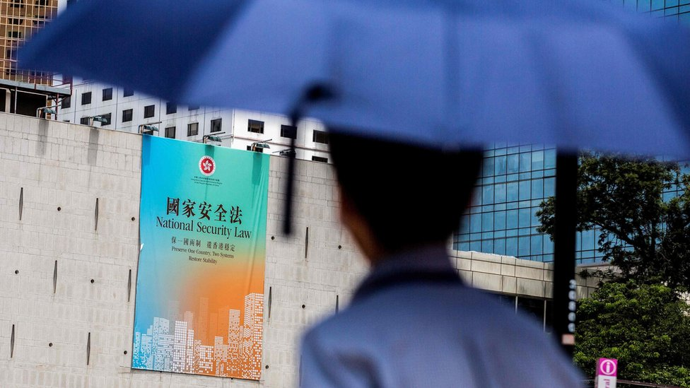 This file photo taken on 29 June 2020 shows a government advertisement promoting China`s planned national security law, displayed on the city hall building in Hong Kong
