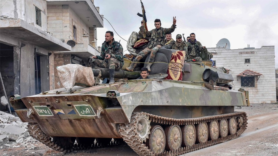 Syrian army soldiers pass through the villages of Deir Sharqi and Talmans, on the outskirts of Maarat al-Numan on 28 January 2020