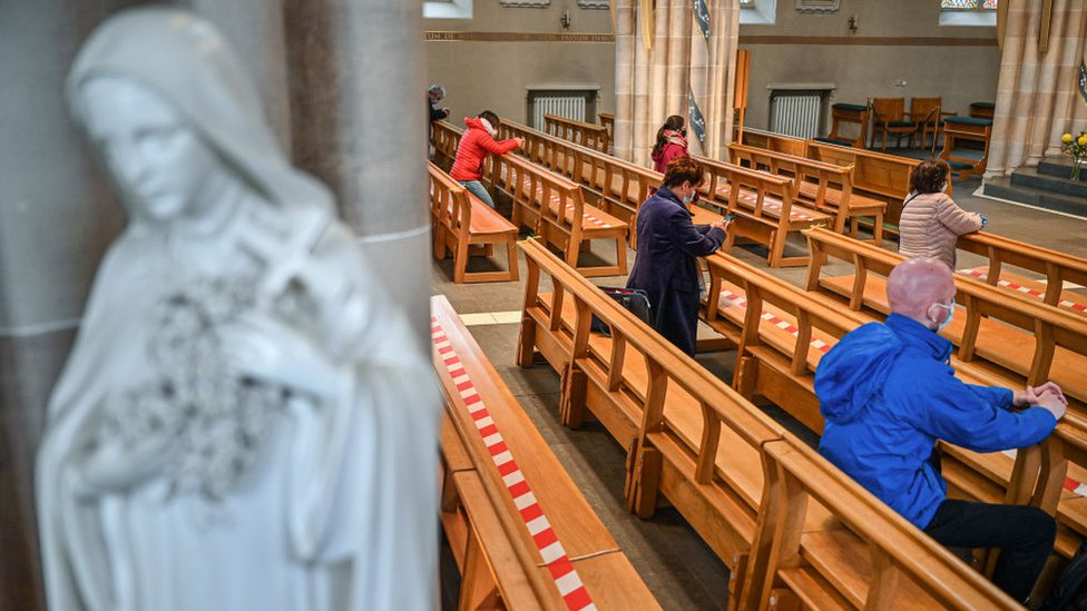 Members of the public pray at St Andrew Cathedral