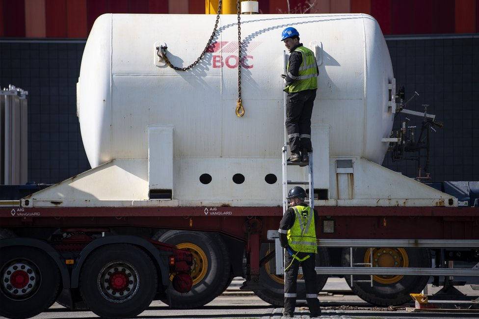 An oxygen cylinder is delivered to the Nightingale hospital at the Excel Centre in London