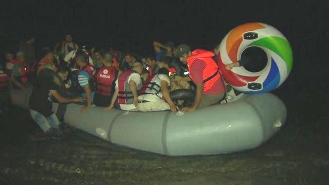 Boat of migrants arriving on Greek island Kos