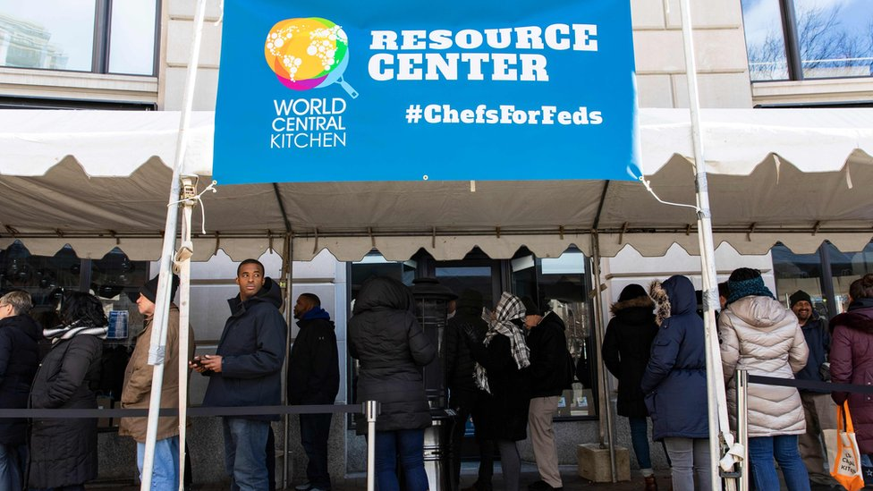Federal employees wait in line at World Central Kitchen, a food bank and food distribution centre in Washington on January 25, 2019