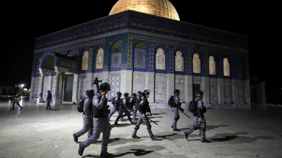 Israeli police walk near the Dome of the Rock during clashes with Palestinians, 7 May