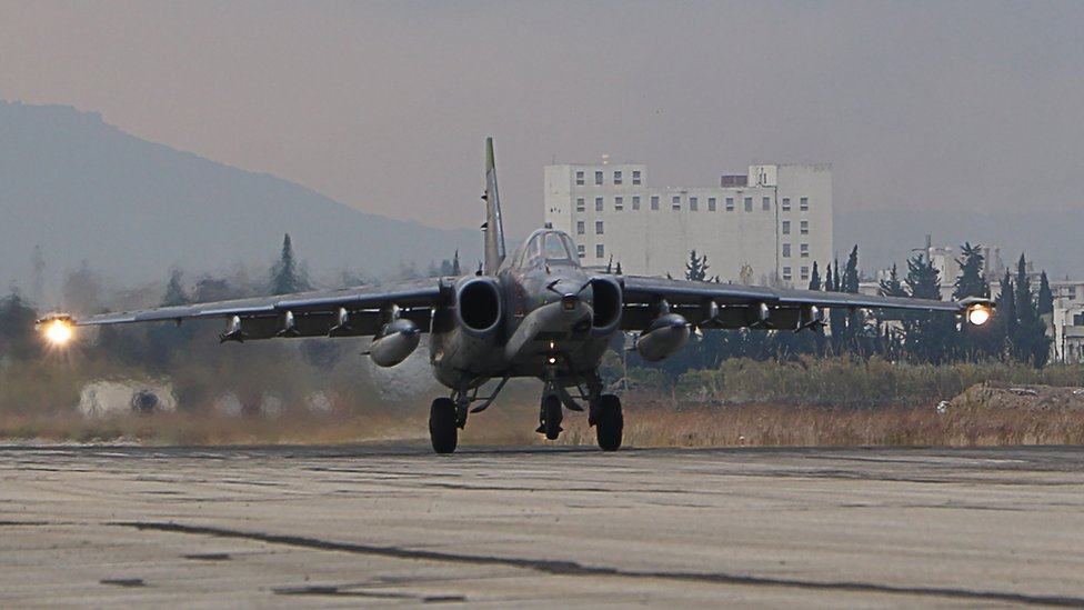 A Russian bomber lands at the Russian Hmeimim military base in Latakia province, in the northwest of Syria, 16 December 2015