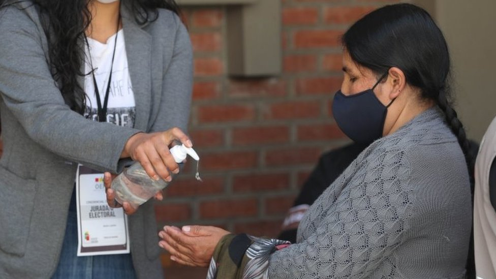 Citizens participate in a mock voting with biosafety measures, in La Paz, Bolivia, 09 October 2020 (issued 12 October).