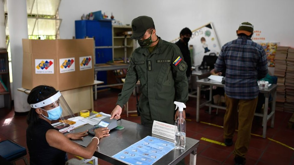 A Venezuelan soldier votes at a polling station in Caracas, on December 6, 2020