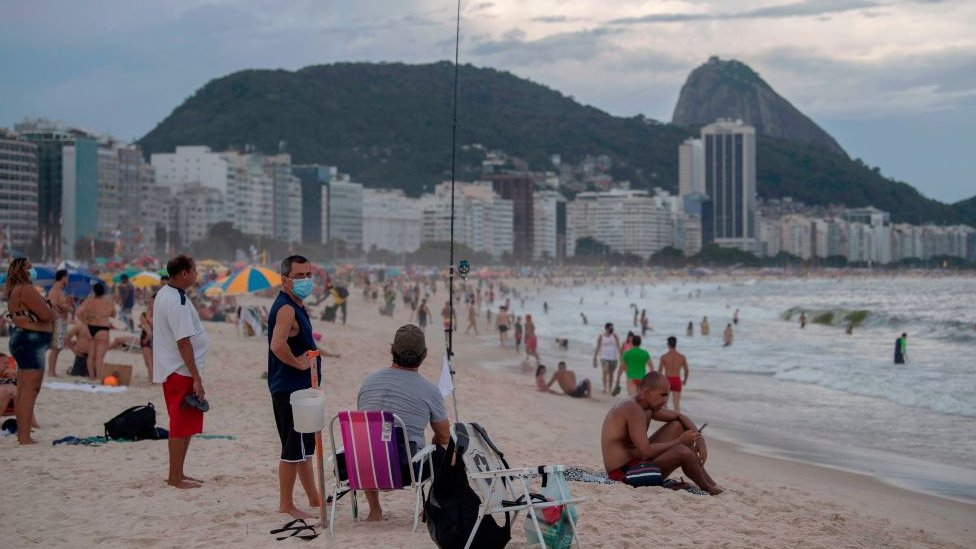 Beachgoers at the Copacabana beach in Rio