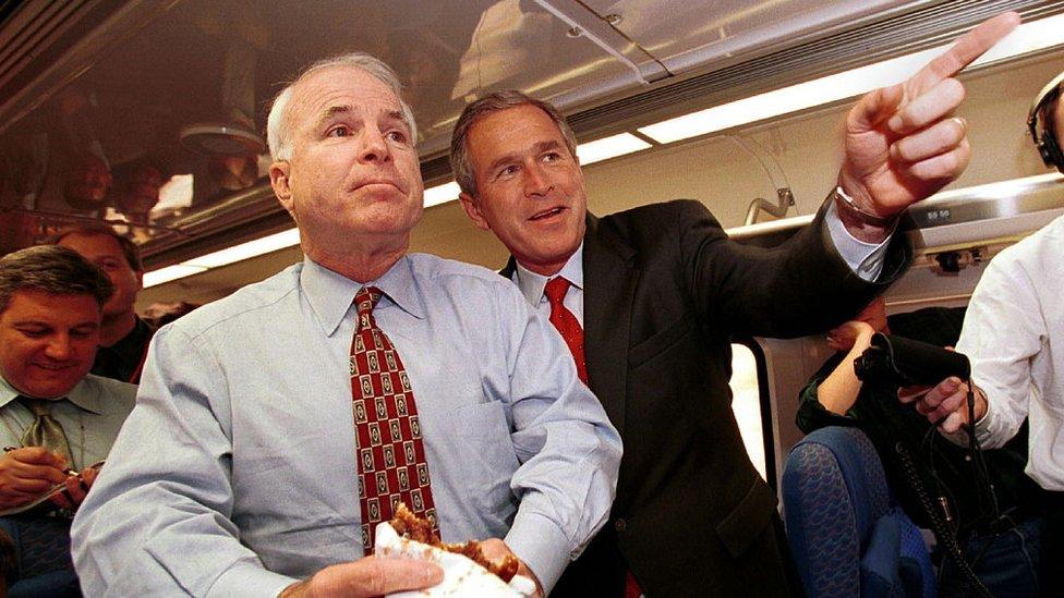 John McCain and George W Bush speak with reporter on Mr Bush's campaign train while in California
