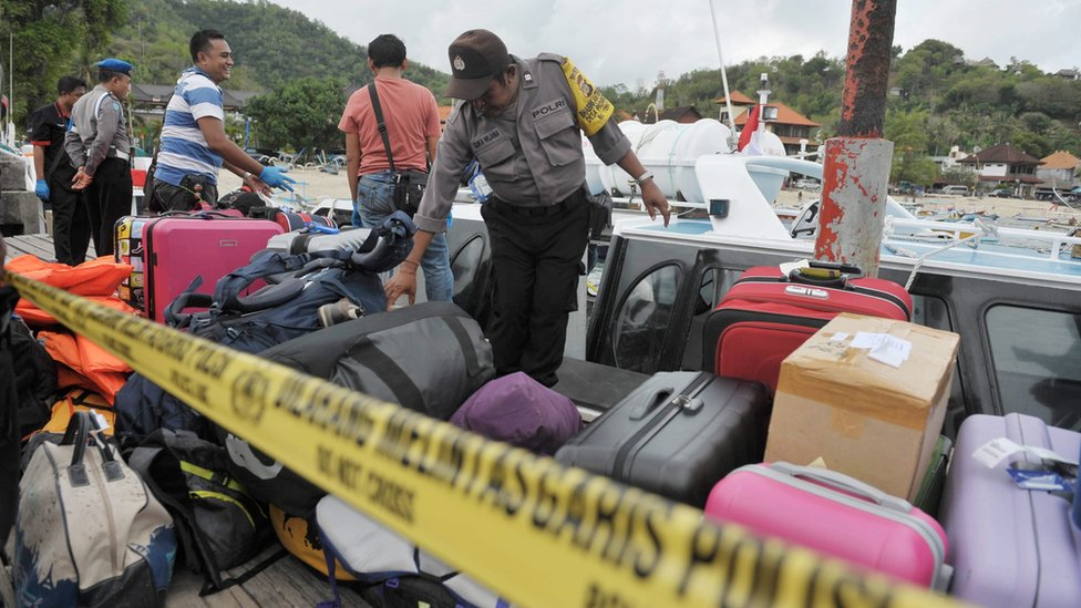Indonesian police investigate the exploded tourist boat at Padang Bai port in eastern Bali, Indonesia, on 15 September