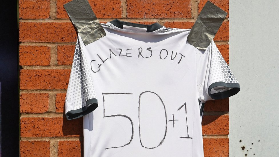 'Glazers Out' written on a shirt outside Old Trafford
