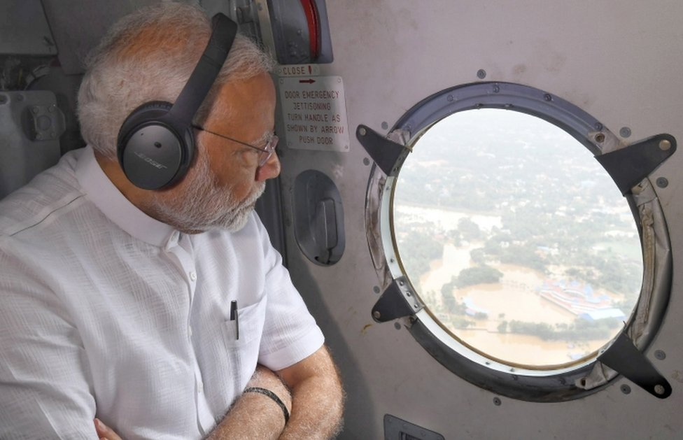 A handout photo made available by the Indian Press Information Bureau (PIB) shows Indian prime minister Narendra Modi conducting an aerial survey of flood affected areas in Kerala